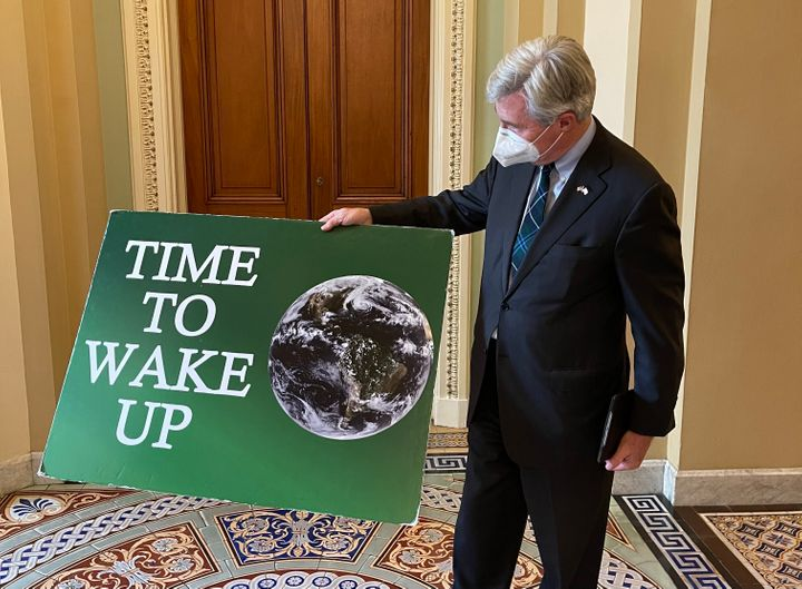 """Hope to God I won't need to bring it back out,"" Sen. Sheldon Whitehouse said of his ""Time To Wake Up"" sign."