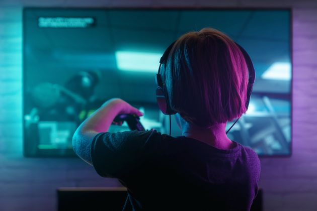 Little boy playing video game in the dark
