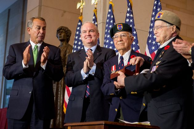 Then-U.S. House Speaker John Boehner, left, and then-Minister of Veterans Affairs Erin O'Toole, second...