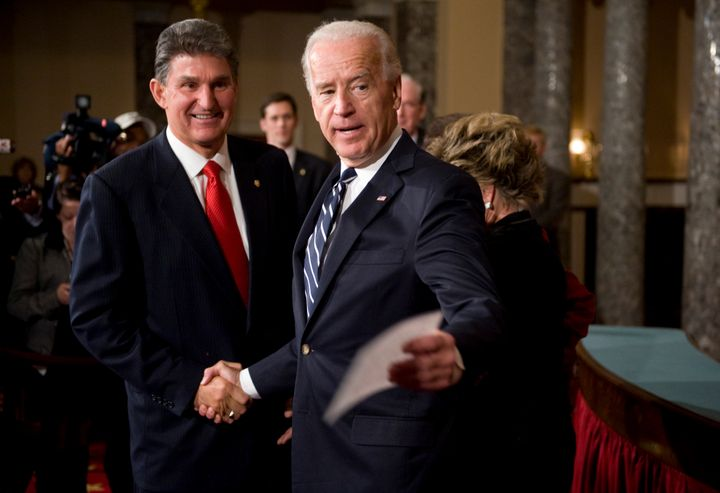 President Joe Biden needs the support of Sen. Joe Manchin (D-W.Va.) (left) to pass any COVID-19 relief bill. WorkMoney is hop