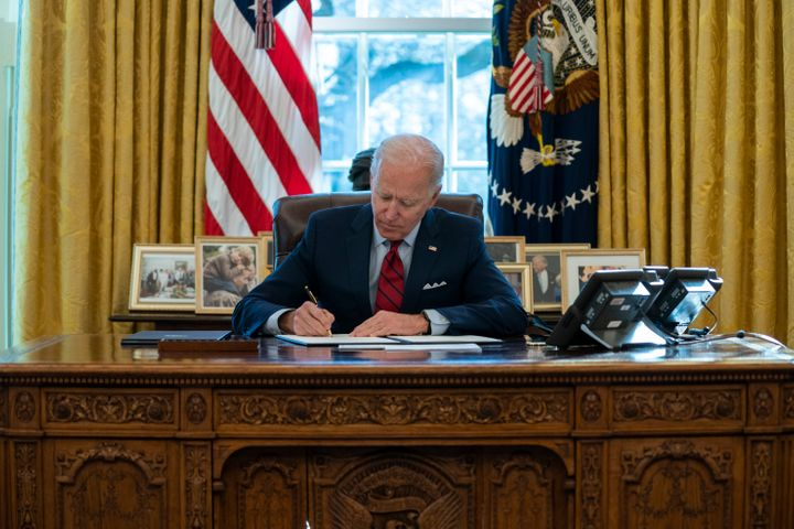 President Joe Biden signs a series of executive orders on health care on Thursday at the White House. The start of his admini