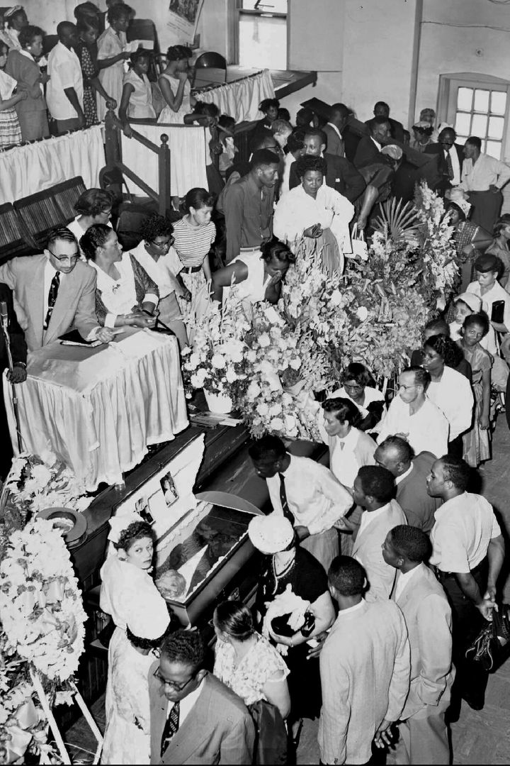 Mourners pass Emmett Till's open casket in Chicago during his funeral in 1955.