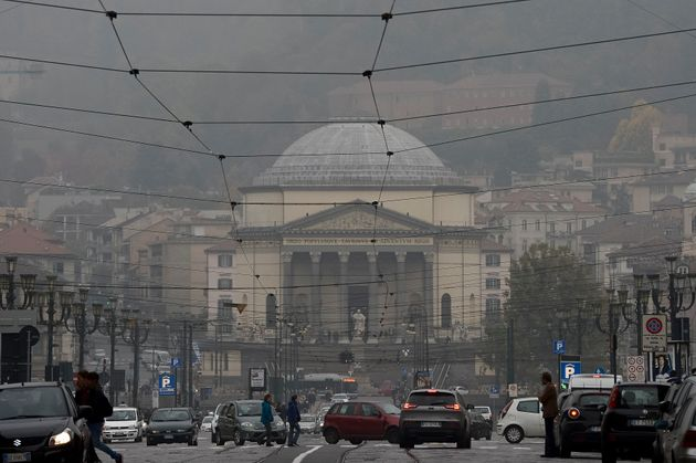 VIA PO, TURIN, ITALY - 2017/10/21: A view of Piazza Vittorio on a day of environment alert due to air...
