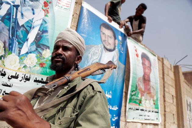 SANA'A, YEMEN - JULY 15: A man from the Al-Muhamasheen community holds a rifle during a protest against...