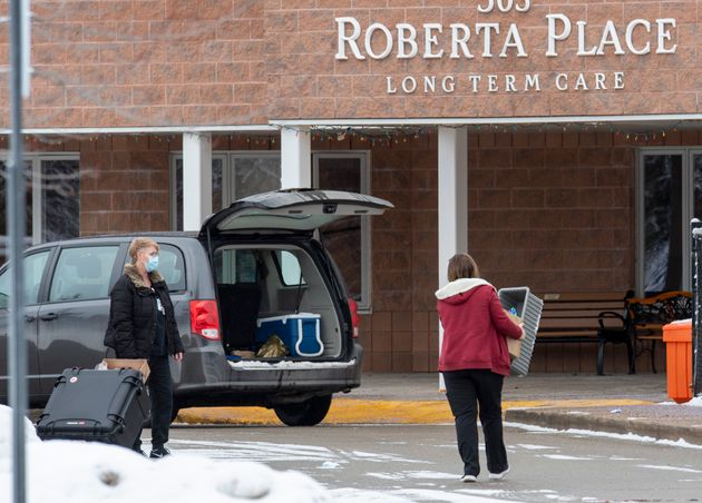 Workers arrive at the Roberta Place Long Term Care in Barrie, Ont. on Jan. 18, 2021.