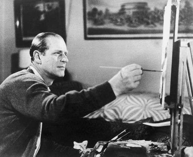Prince Philip at work on one of his hobbies, painting, on June 19, 1969, as seen in a scene from the...