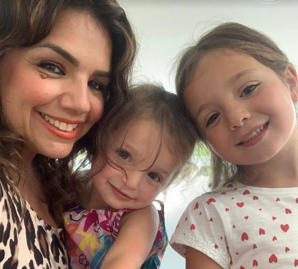 Ozel Ekrem with her two
