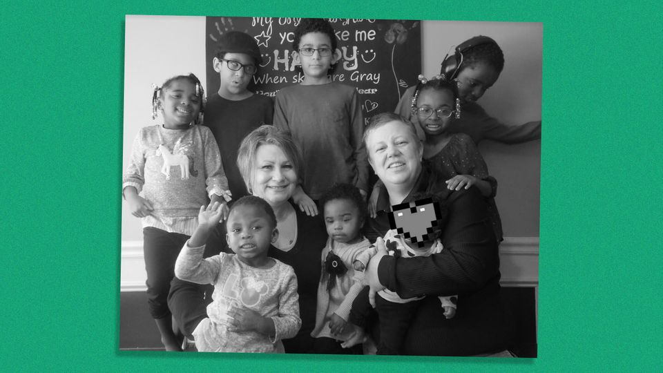 Diana Wright (right), her partner and their family. Seven of the children are adopted, all with disabilities....