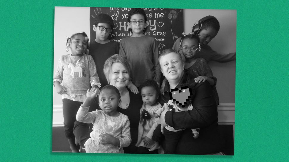 Diana Wright (right), her partner and their family. Seven of the children are adopted, all with disabilities. An eighth child
