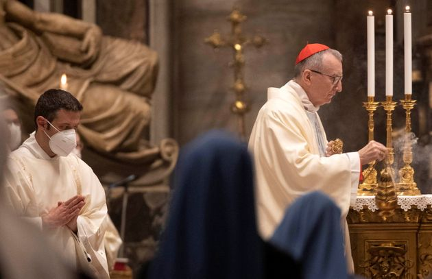Vatican secretary of state Cardinal Pietro Parolin spreads incense during Mass to mark World Day of Peace...