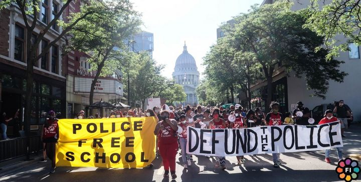 Shyra Adams leads a protest in June to remove police from schools in Madison, Wisconsin. Adams joined other youth activists i