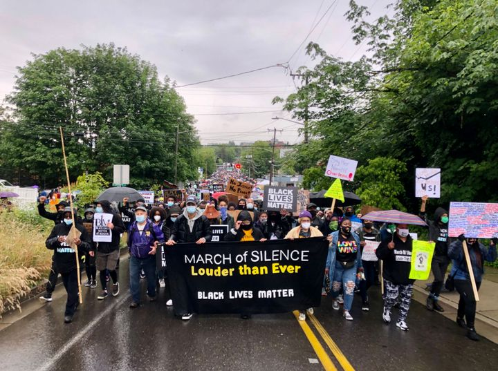 Black youth and Black Lives Matter Seattle-King County lead a silent march of an estimated 60,000 people in June to show supp