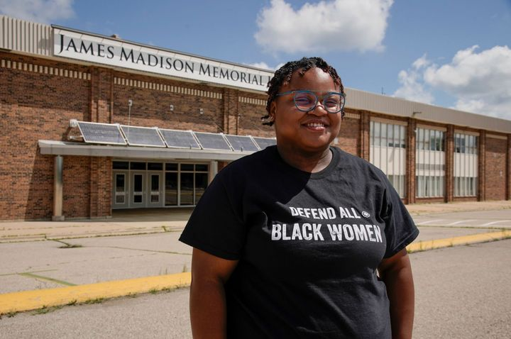Adams stands outside James Madison Memorial High School. As a student there, she began organizing other youth activists to re