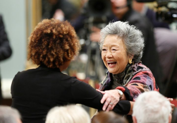 Former Governor Generals Adrienne Clarkson (R) and Michaelle Jean greet each other during a ceremony at Rideau Hall in Ottawa on Nov. 4, 2015.