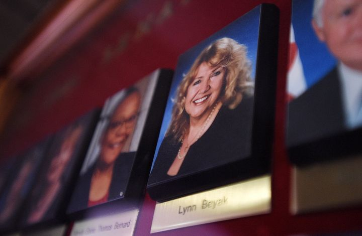 A picture of Lynn Beyak accompanies other senators' official portraits on a display outside the Senate on Parliament Hill in Ottawa on Sept. 21, 2017.