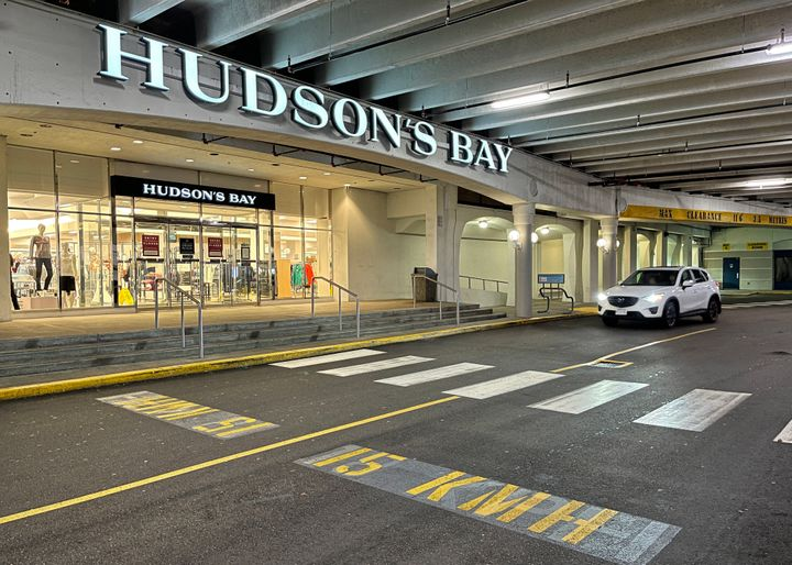 A vehicle passes the storefront of a Hudson's Bay department store on Nov. 22, 2020 in Richmond, B.C.