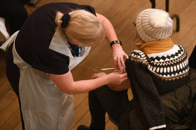 A healthcare professional administers a dose of Covid-19 vaccine at the vaccination centre in Thornton-Cleveleys,...