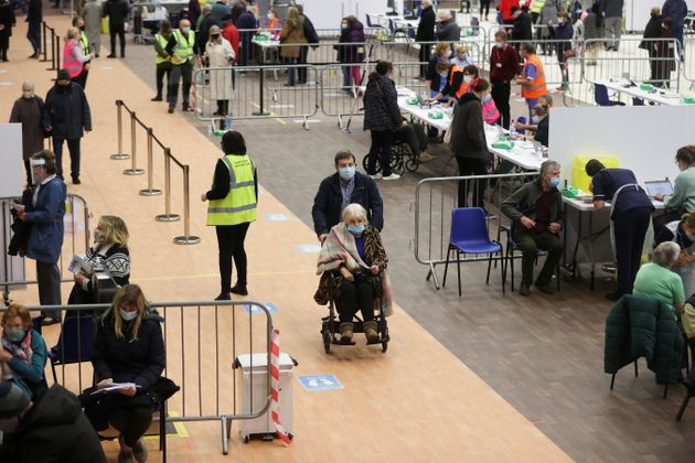 People receive the COVID-19 vaccine at the Derby Arena velodrome in Derby, Derbyshire, Britain, January...