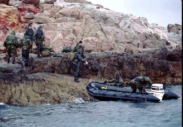 A Turkish SWAT team prepares to leave one of the controversial Kardak (Imia) islets after Greek troops were withdrawn from another one of the islets early Wednesday morning, Jan. 31, 1996. The Turkish commandos landed on the islet with a swift and quiet midnight operation, but didn't have to stay for long. The United States intervened to end the three-day crisis between Turkey and Greece because of claims by both on the uninhabited islets in the Aegean. (AP Photo/Hurriyet)
