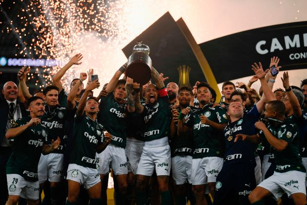 Players of Palmeiras celebrate with the trophy on the podium after winning the Copa Libertadores football...