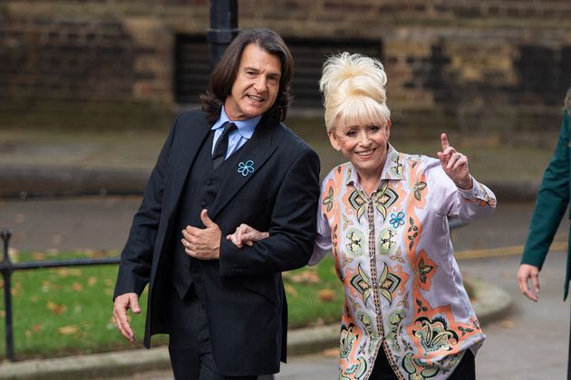 Dame Barbara Windsor and Scott Mitchell in the gardens of Downing