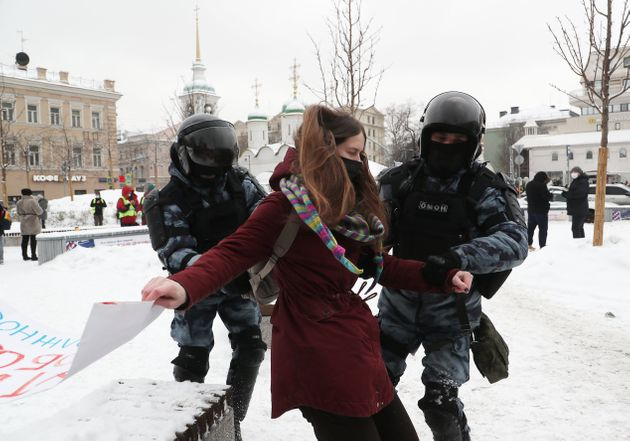 MOSCOW, RUSSIA - JANUARY 31, 2021: Riot police detain a participant in an unauthorized protest in support...