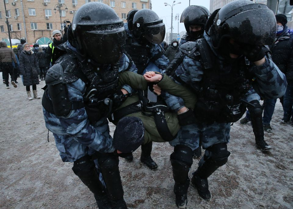 MOSCOW, RUSSIA - JANUARY 31: (RUSSIA OUT) Police detain a man during an unauthorized protest rally against...