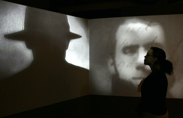A short movie about Jack the Ripper plays at a Museum in Docklands' exhibition in London, on May 14,...