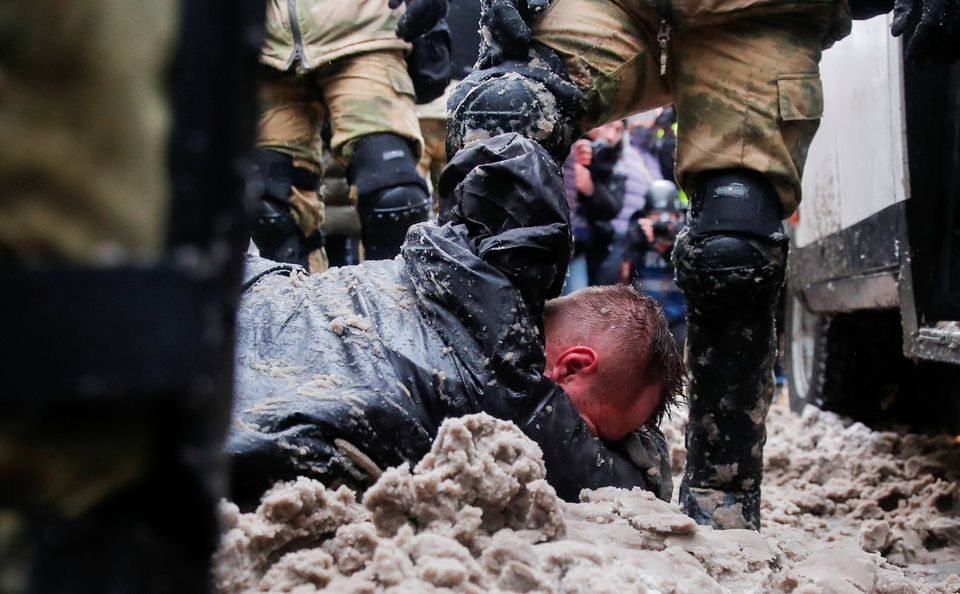Law enforcement officers detain a protestor during a rally in support of jailed Russian opposition leader...