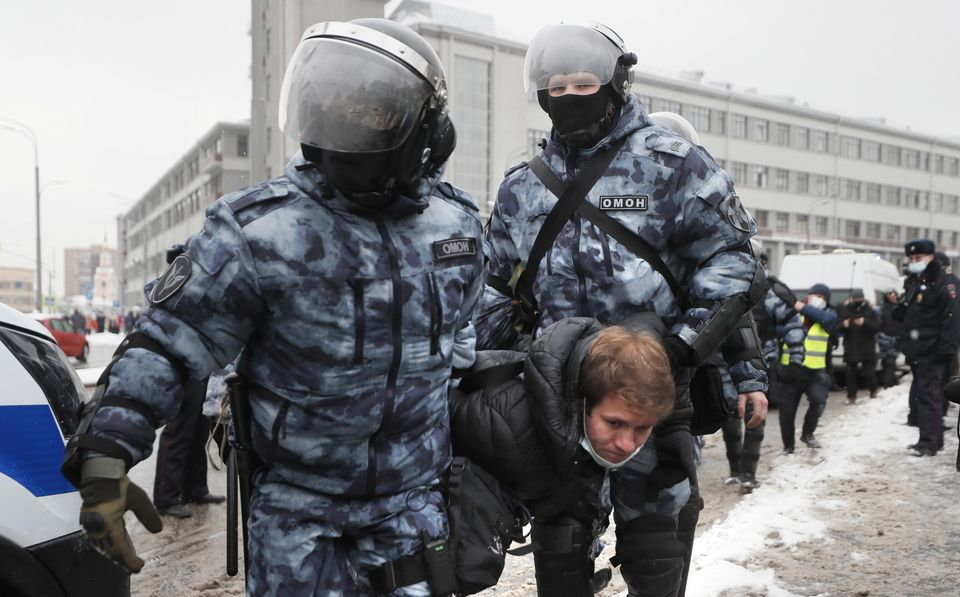 epa08976825 Russian police officers detain protester during an unauthorized protest in support of Russian...