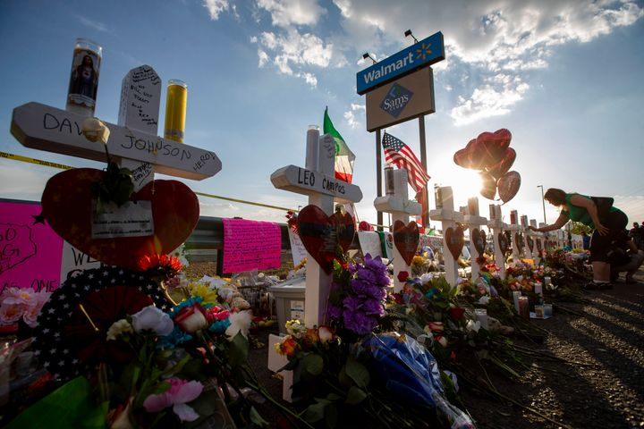 Crosses with names of victims are placed near the Walmart center where a massive shooting took place in El Paso, Texas, on Au
