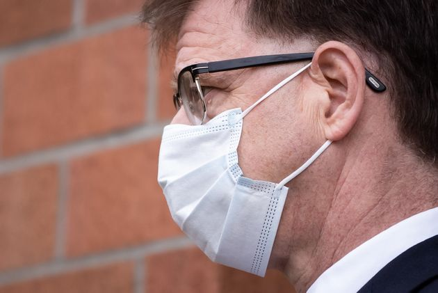 British Columbia Health Minister Adrian Dix wears a face mask to curb the spread of COVID-19 on Aug....