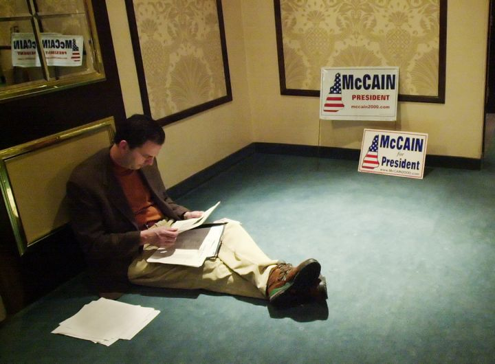John Weaver, then-adviser to U.S. Sen. John McCain, reads over some papers during McCain's 2000 presidential campaign in New