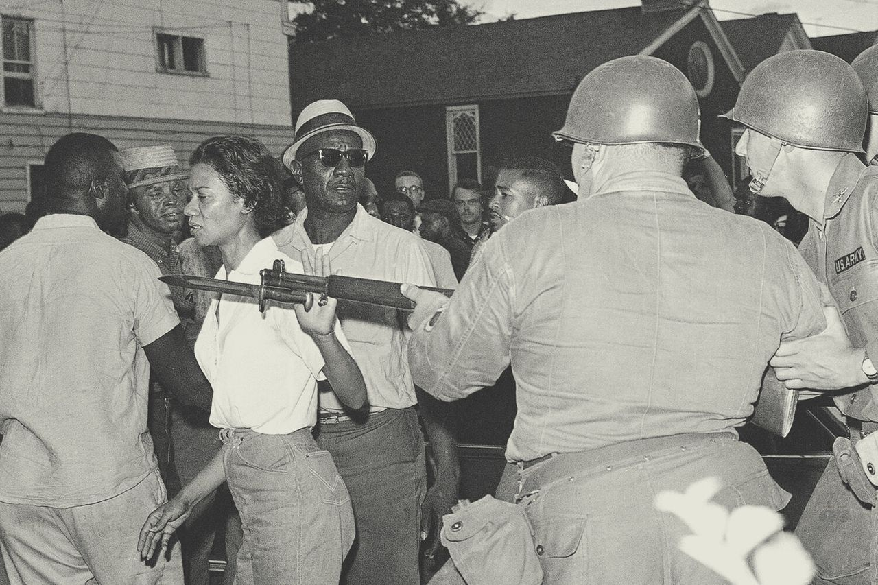 Gloria Richardson, head of the Cambridge Nonviolent Action Committee, pushes a National Guardsman's bayonet aside in Cambridge, Maryland, on July 21, 1963. The crowd gathered after several Black Americans attempted to enter a street sealed off by troops. Richardson and Fred Jackson (left), a CNAC official, appealed to the crowd to disperse after the Guard threw a tear-gas grenade. <em>AP Photo</em>