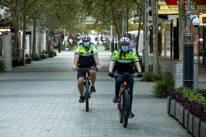 Police are seen patrolling the CDB an hour into the lockdown on January 31, 2021 in Perth, Australia.