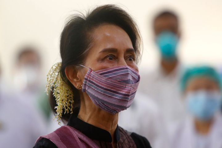 Myanmar leader Aung San Suu Kyi watches the vaccination of health workers at hospital Wednesday, Jan. 27, 2021, in Naypyitaw,