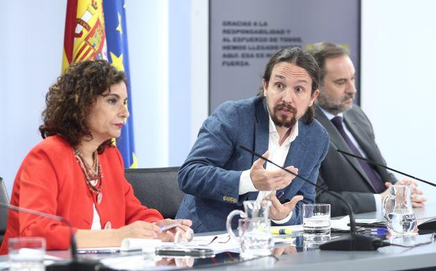 Los ministros María Jesús Montero, Pablo Iglesias y José Luis Ábalos, durante la rueda de prensa posterior a un Consejo de Ministros en julio de 2020 (EUROPA PRESS/E. Parra. POOL/Europa Press via Getty Images).
