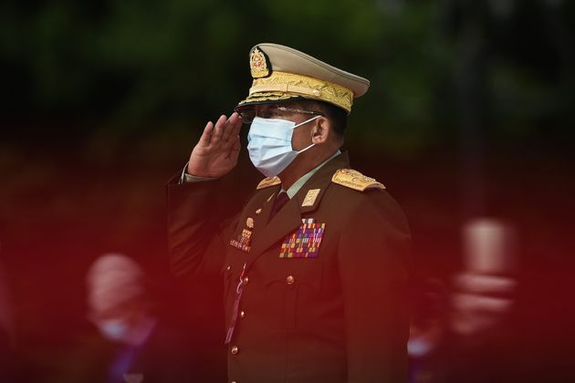 Myanmar's Army Chief Min Aung Hlaing salutes during the 73rd anniversary of the Martyrs' Day ceremony...