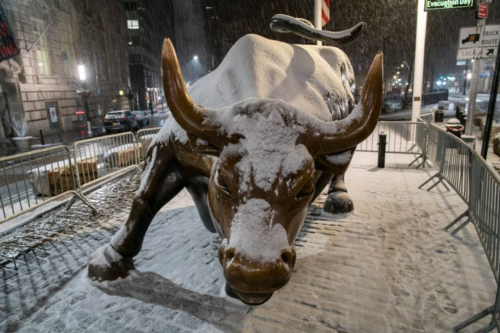 The bull of Wall Street is seen during the snowstorm that began on Sunday in New York City. New York City Mayor Bill de Blasi
