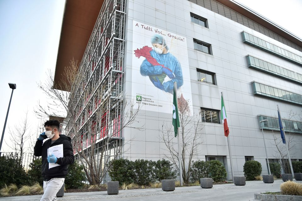 A man walks in front of Bergamo hospital as the number of coronavirus cases (COVID-19) grows around the...