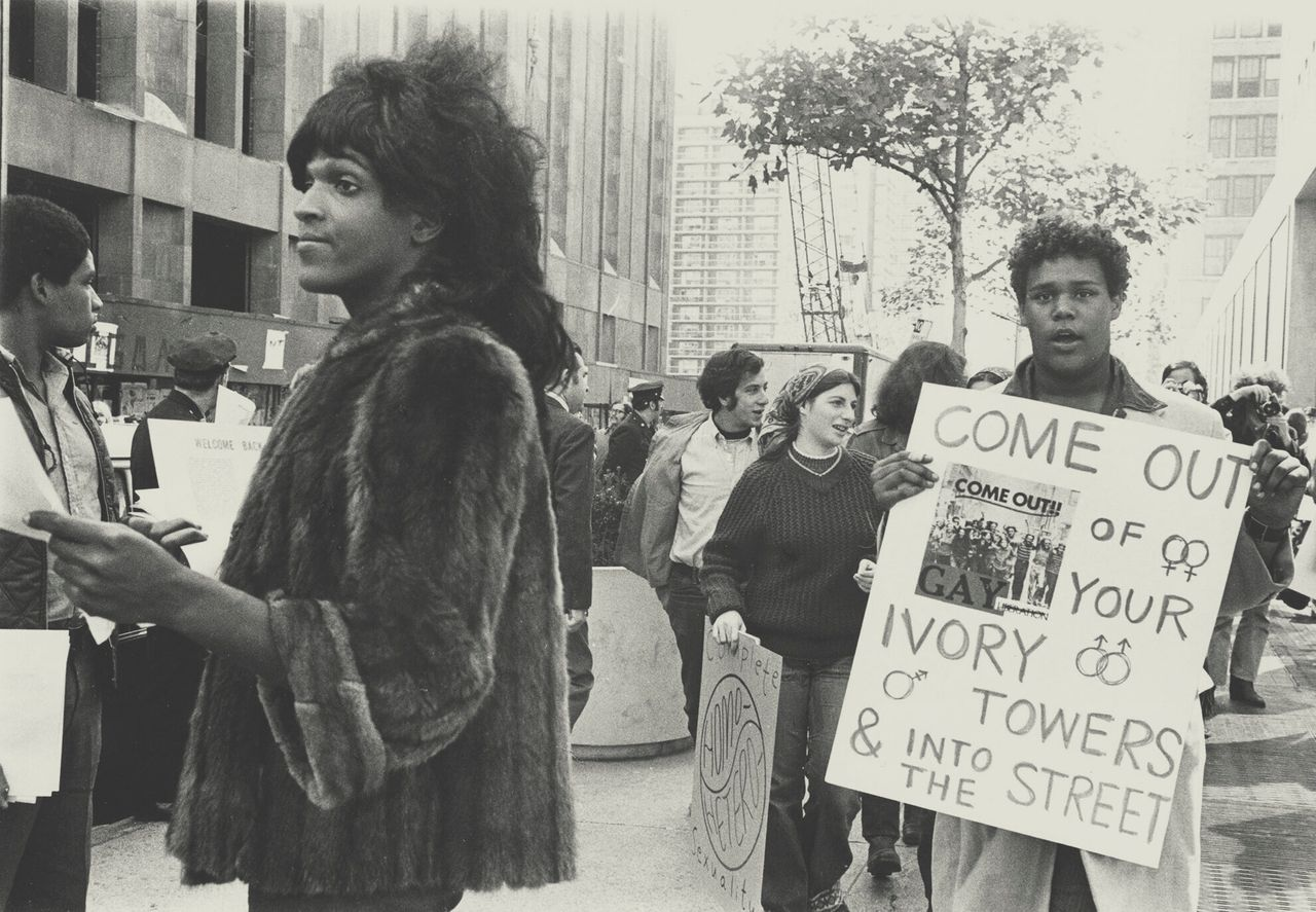 """A 1970 photo of Marsha P. Johnson handing out flyers in support of Gay Students at NYU is seen here courtesy of the New York Public Library's """"1969: The Year of Gay Liberation"""" exhibit. <em>Diana Davies-NYPL/Handout/Reuters</em>"""