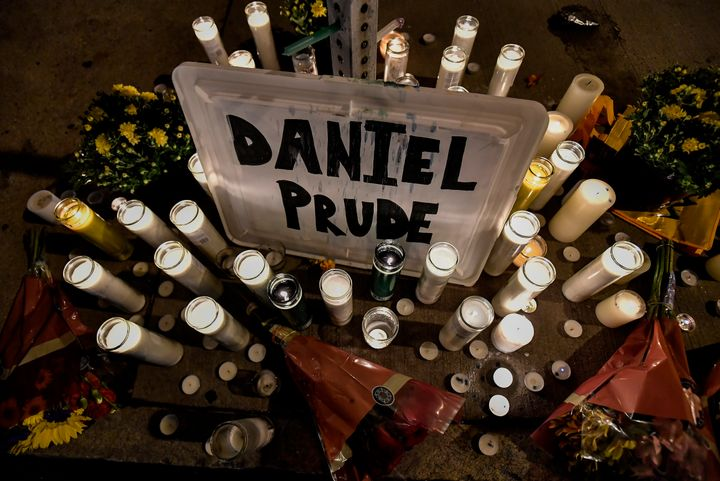 Candles light a makeshift memorial for Daniel Prude, a Black man who died while restrained in police custody in Rochester, Ne