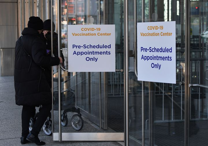 People enter a COVID-19 vaccination center on Jan. 28, 2021, in New York City.