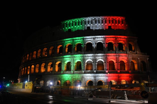ROME, ITALY - JUNE 02: Colosseum is illuminated in the colours of the Italian flag to mark Italy Republic...