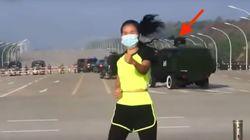 Woman Calmly Teaches Aerobics Class As Military Coup Unfolds Behind