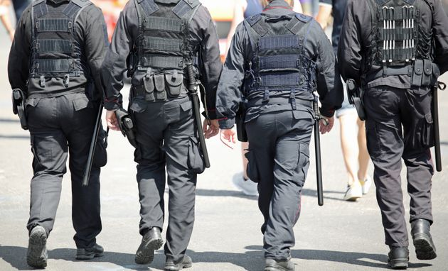 four policemen of special force unit patroling the city with bulletprof vest