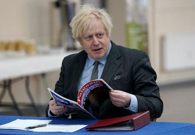 Boris Johnson, not reading the