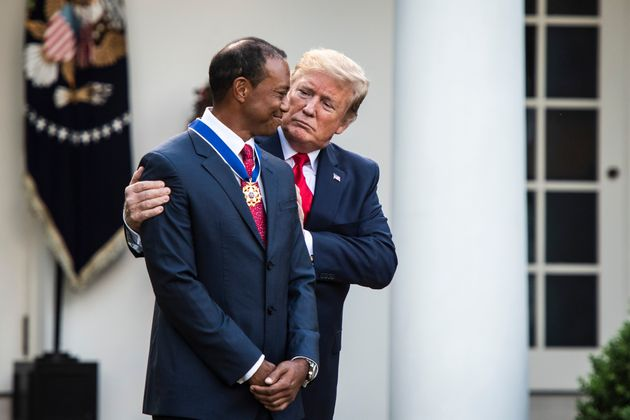 Donald Trump awarding the Medal Of Freedom to Tiger Woods in