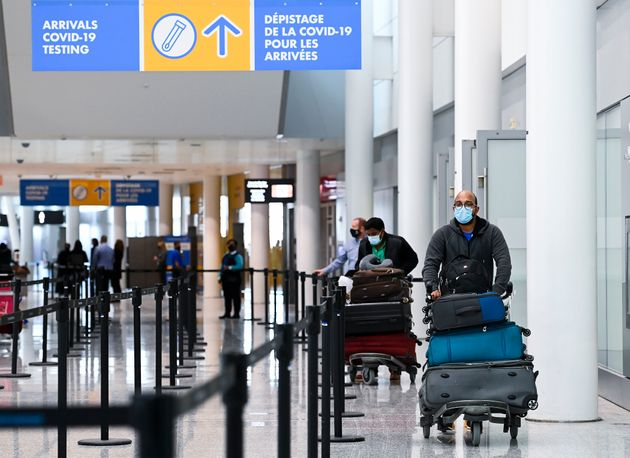 Travellers make their way through Toronto Pearson International Airport in Mississauga, Ont., on Feb....