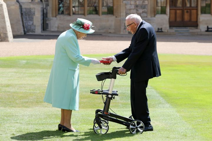 Captain Sir Thomas Moore receiving his knighthood from Queen Elizabeth II during a ceremony at Windsor Castle last year
